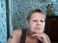 Bekijk de details van camgirl Merel (55 jaar)